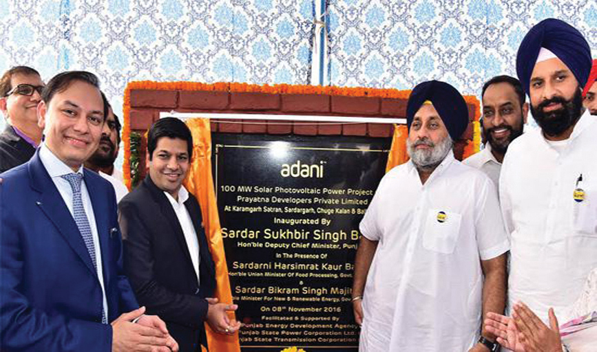 Sukhbir Singh Badal, Deputy Chief Minister, Punjab (third from right), inaugurates the Adani Group's 100 MW solar power plant
