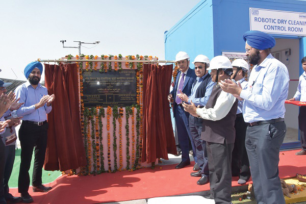 A.K. Jha (fourth from right), inaugurates a robotic dry cleaning system for solar panels at a solar PV plant at NTPC Dadri in the presence of senior company officials