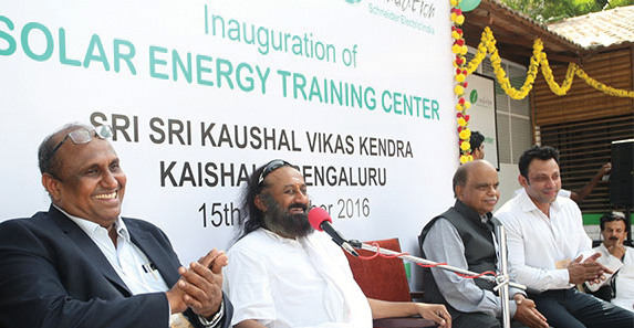 (From left) S. Nagarajan, VP, National Sales, Schneider Electric; Sri Sri Ravi Shankar, Founder, The Art of Living; and Vinod Bihari, Chief Executive Officer, Power Sector Skill Council, at the inauguration of the Solar Energy Training Center set up by Schneider Electric and The Art of Living