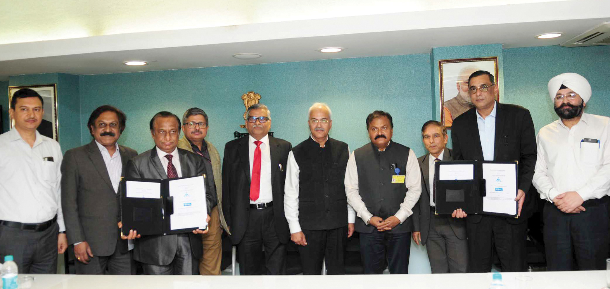 Ajay Kumar Bhalla, Secretary, Ministry of Power (centre); and Guruprasad Mohapatra, Chairman, Airports Authority of India (AAI) (fourth from right), at an MoU signing ceremony for installing energy-efficient LED lights at airports, buildings and facilities owned by AAI, in New Delhi