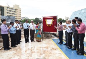 Chikkananjappa, Managing Director (MD), Mangalore Electricity Supply Company (centre), inaugurates the rooftop solar photovoltaic plant at the indoor sports complex at Manipal University