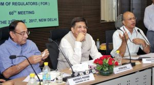 (From left) Gireesh B. Pradhan, Chairman, Central Electricity Regulatory Commission; Piyush Goyal; and P.K. Pujari, Secretary, Ministry of Power, at the Forum of Regulators