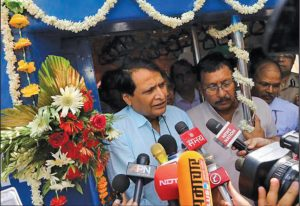 Suresh Prabhu, Minister of Railways (left), at the launch of Indian Railways' first solar-powered diesel electric multiple unit train at Safdarjung railway station