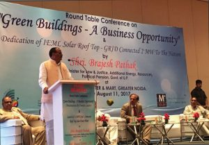 "Brajesh Pathak, Minister of Law & Justice, Additional Energy, Resources, Political Pension, Government of Uttar Pradesh, speaks at a round table conference on ""Green Buildings – A Business Opportunity"", at the inauguration of a 2 MW grid-connected rooftop solar project by India Exposition Mart Limited"