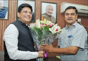 Piyush Goyal, Minister of Railways and Coal (left), greets Raj Kumar Singh, the new Minister of State (Independent Charge) for Power and New and Renewable Energy