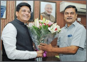 Piyush Goyal (left), greets Raj Kumar Singh, the new Minister of State (Independent Charge) for Power and New and Renewable Energy