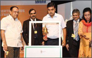 Raj Kumar Singh (centre) launches the Trading of Energy Saving Certificates as Gireesh B. Pradhan, Chairperson, Central Electricity Regulatory Commission (left), looks on