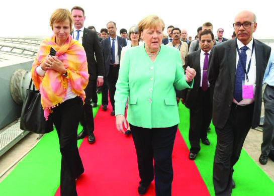 Dr Angela Merkel, Chancellor of Germany (centre), visits Delhi Metro Rail Corporation's (DMRC) rooftop solar power plant at Dwarka Sector 21 metro station with Dr Mangu Singh, Managing Director (MD), DMRC (right)