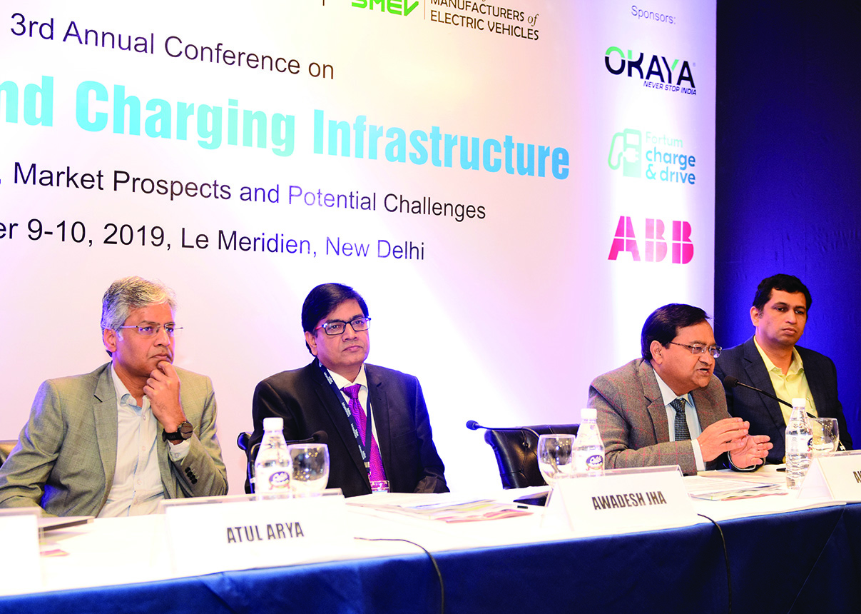 "(From left) Atul Arya, Head, Energy Systems Division, Panasonic India; Awadhesh Kumar Jha, Vice President, Charge and Drive and Sustainability, Fortum Charge and Drive India; Dr A.K. Jain, MD, REIL; and Maxson Lewis, MD, Magenta Power, at the ""E-Mobility and Charging Infrastructure"" conference"